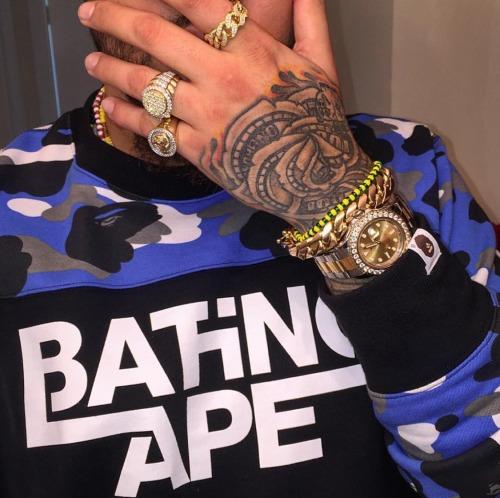 a bathing ape bape gold watch gold rings gold bracelet dope dope shit dopeness thugofarabia