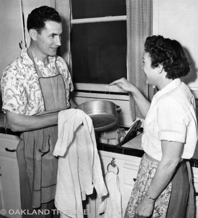 Pittsburg, CA February 15, 1950 - Vince DiMaggio helps his wife Lee in the kitchen. DiMaggio was managing the Pittsburg Diamonds, a minor league baseball team. (Oakland Tribune Staff Archives)