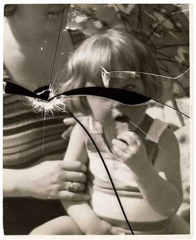 lauramcphee: [Mother w/Child on Beach, Reflected in Broken Mirror] 1920s (Martin Munkacsi)