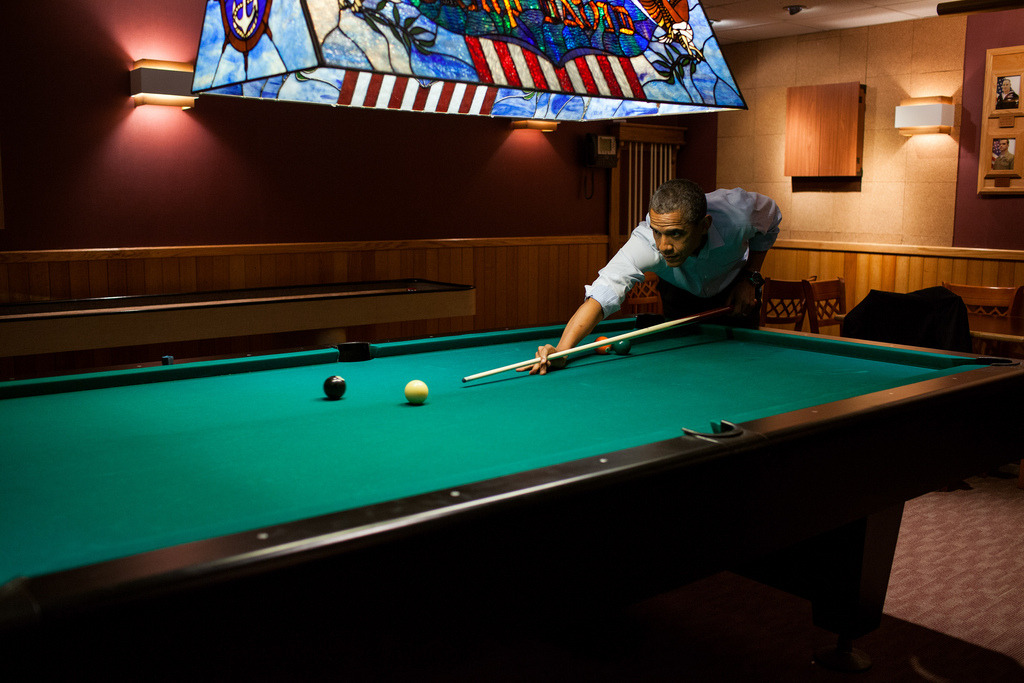President Barack Obama plays a game of pool following the conclusion of the G8 Summit at Camp David, Md., May 19, 2012. (Official White House Photo by Pete Souza)   Most iconic Pete Souza photos of Obama family's first 4 years in the White House