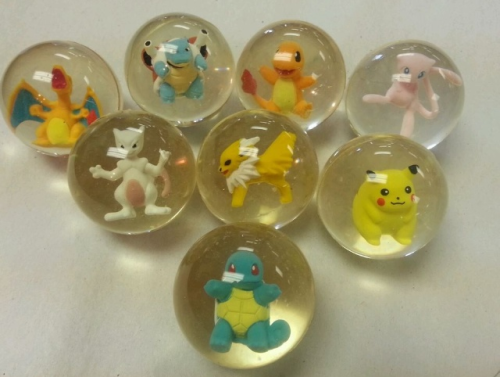 timetravelingclarinetist:  Omg!  I had the pikachu one when I was a kid and after like 10 years the ball split open and the cute little pika came out.