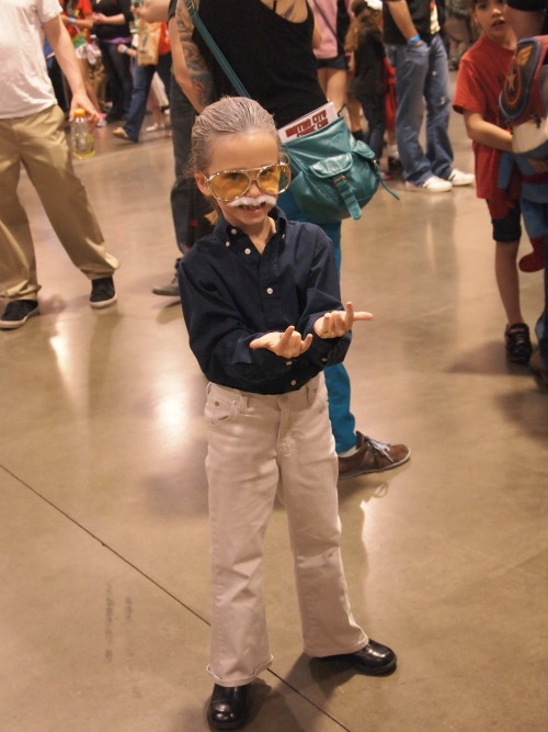 cosmicbrownie:  Little girl dressed as Stan Lee at Motor City Comic con!!!  Now go bully other girls dressed up as Steve Ditko and Jack Kirby