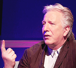 alan rickman pointing up.