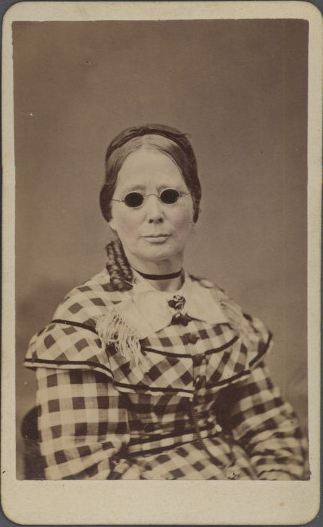 ca. 1860, [carte de visite portrait of a woman, possibly blind, wearing dark glasses and a plaid dress], J.P. Blessing & Co.  via the Southern Methodist University, Lawrence T. Jones III Texas Photography Collection