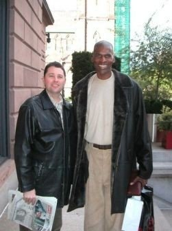 "Tim with #Boston legendary center Robert Parish, ""The Chief"". Remember, Tim is 6'5"", so Robert at 7' is a big man."