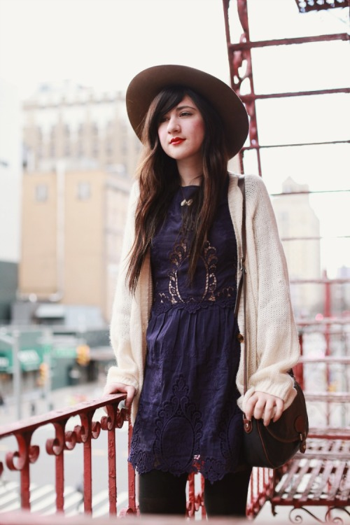 Bonnie of Flashes of Style in a cozy cream-colored cardigan.