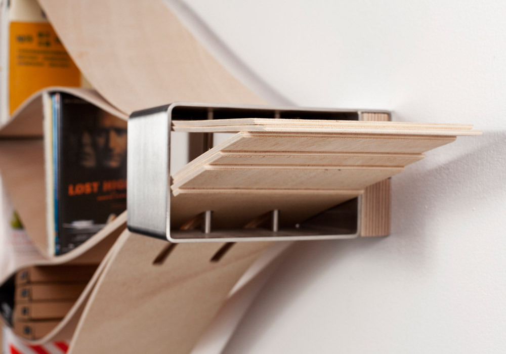 cjwho:  Flexible Wooden Bookshelf Warps to Wrap All Book Sizes