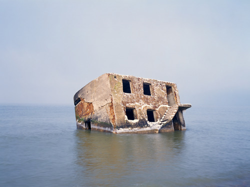 dannyhaines:  Former soviet bunker abandoned in the sea off Liepaja beach, Latvia