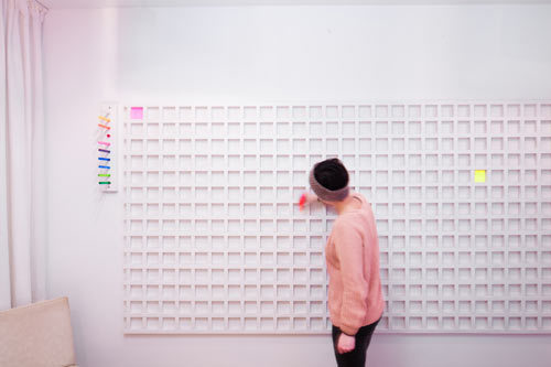 The ART MATRIX is an interactive piece that allows each guest of The Cube Room to color one canvas cube in a color of their choice. Over time, the abstract work will evolve and unite the 400 people from around the world that each have a colored cube.