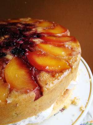 Upside Down Blackberry Peach Pecan Cake with Pecan Kreme Ingredients:1 cup margarine1 cup raw sugar4 eggs3 cups cake flour, sifted1 heaping teaspoon baking powder3/4 pound pecans, chopped medium1 peach, sliced1 cup blackberries1/2 cup brown sugar3 tbsp real butter  Directions:Arrange the peaches and blackberries in a cake pan, sprinkle with brown sugar and then the margarine. Mix the dry ingredients together. Beat the margarine, sugar and then add the egg substitute. Incorporate the dry ingredients,then fold in the pecans. Pour the cake batter over the fruit and bake at 375 degrees for 40 minutes. Allow cake to cool. Remove from pan and slice cake in half- fill with the nut kreme and replace the layer. Serve.