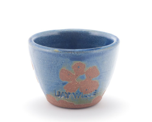 Blue stoneware sake cup with unglazed flower pattern by Jay Wiese, via Etsy