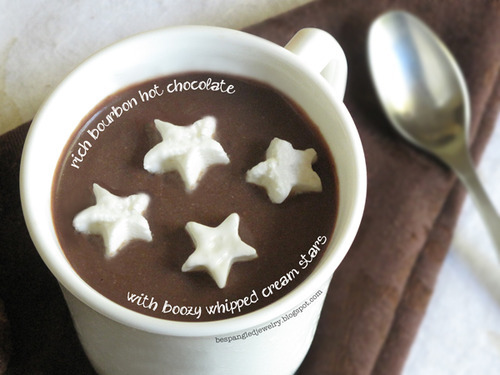 RICH BOURBON HOT CHOCOLATE INGREDIENTS: • 1/2 cup granulated sugar • 3/4 cup bittersweet chocolate chips • 2 TBS dutch-processed cocoa powder* • 1/8 tsp salt • 1/2 cup bourbon  • 1.5 cups water DIRECTIONS: Combine sugar, chocolate, cocoa powder, and salt in a saucepan with water. Warm over medium heat and whisk constantly until mixture just begins to boil. Remove from heat. Add in bourbon and stir just before serving. Use a ladel to spoon into mugs. BOOZY WHIP CREAM STARS INGREDIENTS: • 1 cup heavy cream • 1/3 cup granulated sugar • 2 tsp booze of choice (bourbon, brandy, cointreau, etc.) *I used bourbon :) DIRECTIONS: Combine ingredients in a medium or large bowl and whisk together with an electric beater until soft peaks form on the cream, about 3 minutes. Transfer fresh whipped cream mixture to a wide flat dish (like a pie plate) and smooth mixture flat and as even as possible. Place in the freezer for several hours. When the mixture is frozen, use your favorite mini cookie cutters (like these) to cut out shapes in the whipped cream. Place them on top of your delicious homemade hot chocolate and watch them melt hearts as they melt away!