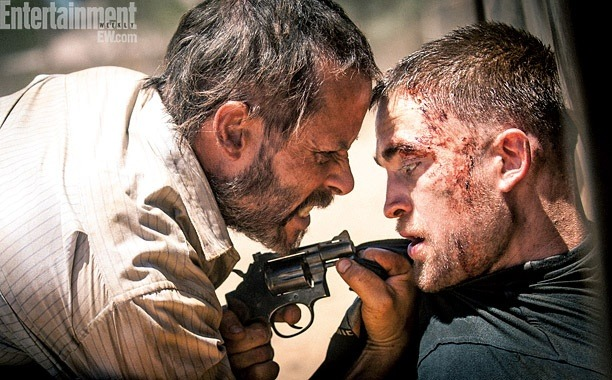 "Here's the first look at Robert Pattinson and Guy Pearce in The Rover.   Director David Michôd describes the upcoming drama:  ""It's like a new gold rush, where people from all corners of the world have come out to the desert to scrape out an existence. Petty criminals and miscreants and hustlers… You've got a really dark, dangerous, murderous person in Guy's character, and in Rob's character you have a quite troubled and damaged, but beautiful and naïve, soul.""  Pick up the latest issue of Entertainment Weekly, on newsstands this Friday, more on The Rover."