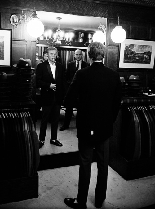 hollywoodlady:   Steve McQueen checks out his reflection as he tries on a suit in a store, Hollywood, California, June 1963. Photo by John Dominis
