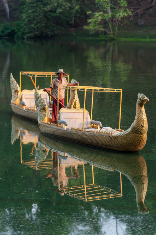 uncommonjones:  Boatman in traditional dragon boat by Marios Forsos Angkor Wat, Angkor, Cambodia