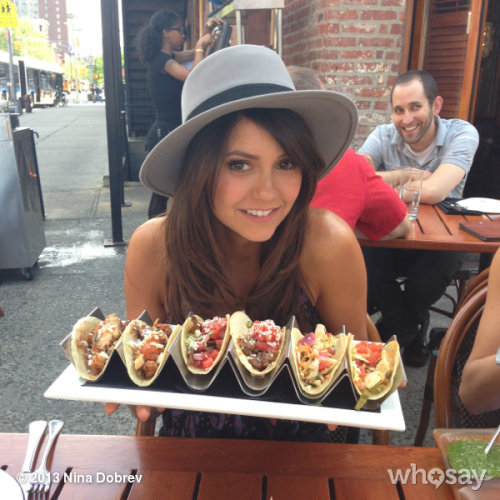 ninadobrev:  Tacos much? Don't think I can eat all this… Mind is bigger than my stomach #whoops #funnyphotobombintheback View more Nina Dobrev on WhoSay