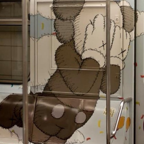 From the outside of subway cars to the inside.  Kaws is just about the best example of Graff to fine artist/ brand. #art #artist #advertising #branding #graffiti #subway #steel #nyc #tc5  (at Jonathan's Fish & Chips)