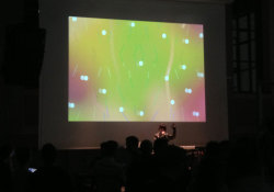 "VJING at Libros Mutantes, Art Book Fair (Madrid) with BFLETCHA (Es) whos music is ""a dizzy, glittering swirl of signature 80s brass hooks, click-clack percussion and playful synth lines all woven up together in her dreamy Spanish vocals."" by Dummy Mag screenshots from live show"