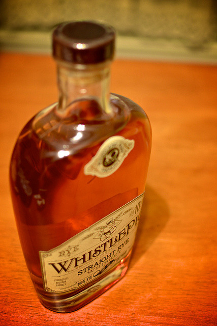 WhistlePig Straight Rye Whiskey on Flickr.Via Flickr: Tasted 3/11/13. It's been an extremely busy month and I've still got one more month of tax season to go.  It was time to try something new… I've always wanted to try WhistlePig based on friends' recommendations. But since it is not so cheap, you don't want a buy a bottle and find out you don't like it. Thank heavens for Five Horses Tavern for having it available.  I finally ordered it and Ben and I got to melt in pure bliss. It is 100 proof and a straight rye whiskey aged in new American oak barrels for at least 10 years.   It is surprisingly smooth for a rye.  I almost compare it to drinking a Macallan scotch.  You get the flare at first taste, but it doesn't hit the back of your throat like many rye whiskies do. It tastes of mint and oak blended into a yummy glass of happiness. So now this is my favorite rye. And Ben even loves it!  Win!
