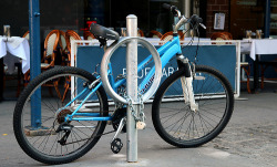 NYC Will Turn 12,000 Old Parking Meters Into Bike Racks- Adele Peters wrote in Cities, New York City and Sustainability Two years ago, New York City's Department of Transportation decided to transform some of the city's decommissioned parking meter poles into bike racks. In part, it was a way to help fix a new problem: when the city installed an electronic multi-meter parking system for cars, and took out the tops of the old parking meters, cyclists suddenly had fewer places to lock their bikes. Of course, those were never official bike racks, and weren't ideally suited for the task. By retrofitting the poles with new circular loops, the city created many more options for bike parking, helping solve the problem of one spot for every 30 cyclists. After the initial trial of 200 meters was deemed a success, the city has decided to continue to retrofit the rest of the poles—12,000 in total. It's a smart idea. The city saves money on new bike racks, and makes use of something that otherwise might be torn up and thrown out. And every small step that makes biking easier, whether it's a better light or somewhere to park, helps get more bikes on the road. Other cities, from Boulder to Sacramento, are using similar designs. Photo via (cc) Flickr user nycstreets