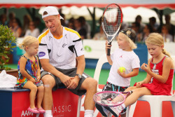 Lleyton Hewitt of Australia talks with his children Ava Hewitt, Cruz Hewitt and Mia Hewitt after winning his match against Juan Martin del Potro of Argentina.