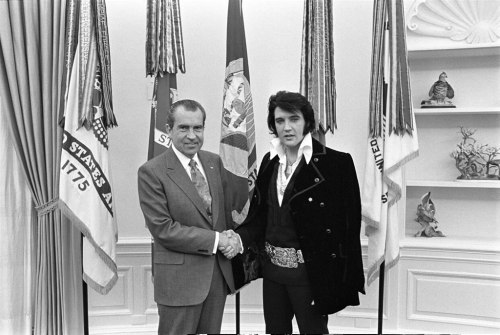Nixon's Surprise Visit from Elvis President Richard Nixon shakes hands with Elvis Presley in the Oval Office.  Presley was born on January 8, 1935, and Nixon was born on January 9, 1913 (100 years ago tomorrow).  Incidentally, the photo from this impromptu meeting on December 21, 1970, is among the most requested from the National Archives.  The Elvis-Nixon meeting draws more inquiries than the Bill of Rights and the Constitution. Birthday cheers for Elvis and Nixon! More — Elvis Presley's surprise visit to the Nixon in the White House -from the Nixon Library