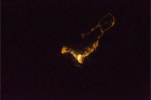 "Chris Hadfield's image of the Grand Cayman at night from the International Space Station, ""you can almost see the undersea cliffs."" Coolest find of the day: Hadfield's tweets from the ISS: pictures, live casts, and a duet with the Barenaked Ladies!  Pretty awesome. https://twitter.com/Cmdr_Hadfield"