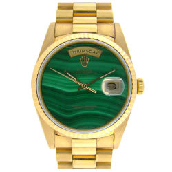 youmightfindyourself:  A very collectable Day Date with unique malachite dial. A double quick Day Date movement. 18K yellow gold case in excellent condition. (via)