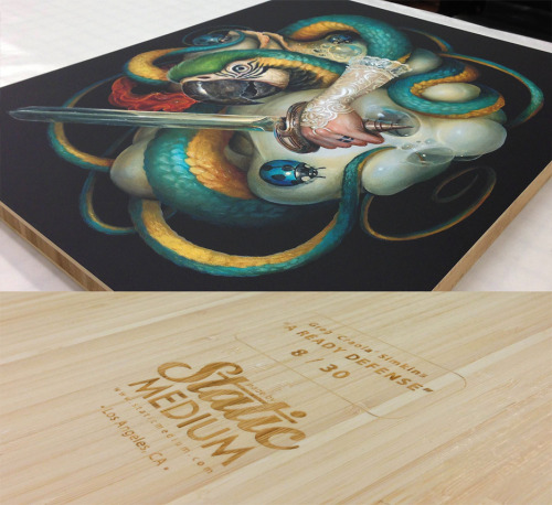 "Finishing laser-etched backs on Greg ""Craola"" Simkins' awesome bamboo-mounted ""A Ready Defense"" prints. Printed and mounted by Matt & Leah at Static Medium Print & Photo"