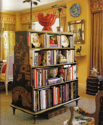 Chinoiserie bookcase in the home of designer Alex Papachristidis. via