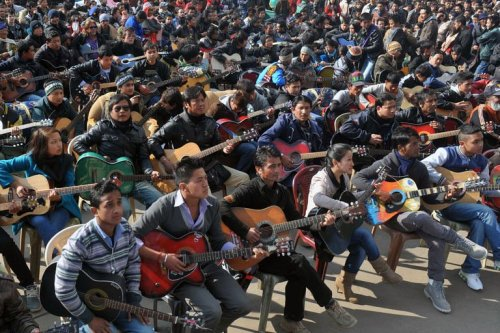 "kimmismiles:  India, in the city of Darjeeling, where 600 guitarists played together ""Imagine"" by John Lennon in tribute to the student who was raped and who died from her injuries. - Imgur"