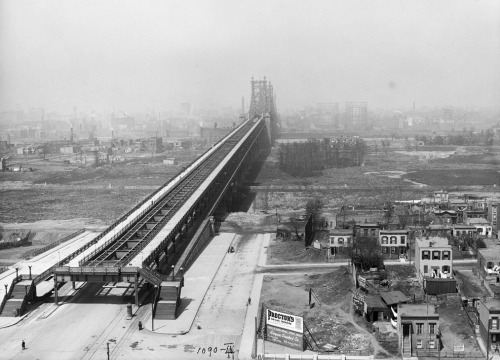 """Queensboro Bridge looking to Manhattan. Queens consists of 19th century wood frame houses, stands of trees, empty fields, a few ponds and streets that just end. New York. May 1912. ""Before the real estate boom years of the 1920s, parts of Queens were still rural or semi-rural, even this close to Manhattan. It's amazing to see how empty all this land was just 100 years ago. ""Large gas storage tanks and smokestacks protrude from the Midtown Manhattan skyline."""