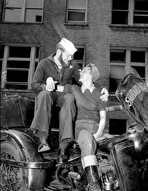 theroamer:  A biker girl and her sailor, c. 1940's.