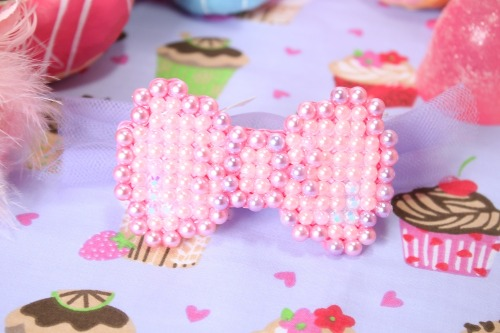 "kittywood:  Pixel Pink Hair Bow now up for sale  on our etsy! use the coupon ""NEWSTOCKSALE""  when you check out to get 20% off your order of 15$ or more sale ends may 20th."