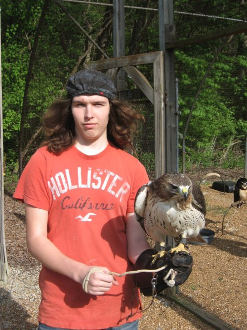 "Hey, this man is holding a bird while he is keepin' on rockin'. He is looking into the camera like ""Yeah, you know it, son. I'm holding a bird and there ain't shit you can do about that."" And you know what? He is right. Because this is a photo and it has already happened such is the nature of photography. Serious."