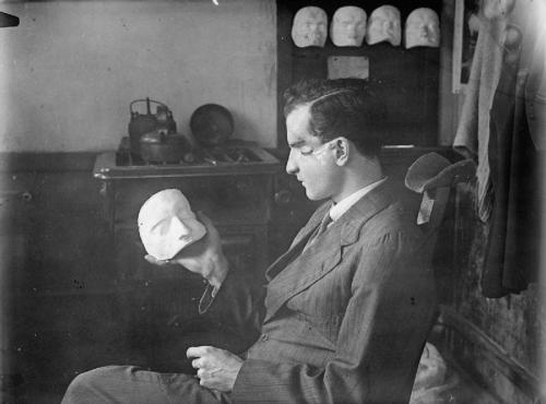 burnedshoes:  © Horace Nicholls / IWM, ca. 1918, WWI soldier facial reconstruction, UK In London and Paris, professional sculptors were responsible for the provision of cosmetic masks to be worn by soldiers badly disfigured during World War I: their results are recorded in the photographs of British home front photographer Horace Nicholls and in a silent film of Anna Coleman Ladd at work in her American Red Cross studio in Paris. Both sources document the artistry of prosthetic repair, and Nicholls' images dramatize the psychological impact of facial mutilation – regarded by many to be the most dehumanizing of injuries. Paradoxically, though, the juxtaposition of human face and portrait mask disturbs the equation of identity and appearance on which traditional portraiture depends. (+) [ IMAGE SOURCES: 1, 4, 2-3, 5-7 ] » find more war & conflict photography here «  Mr. Harrow!