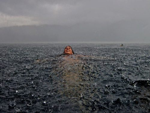 The feeling of swimming in the sea under the rain.