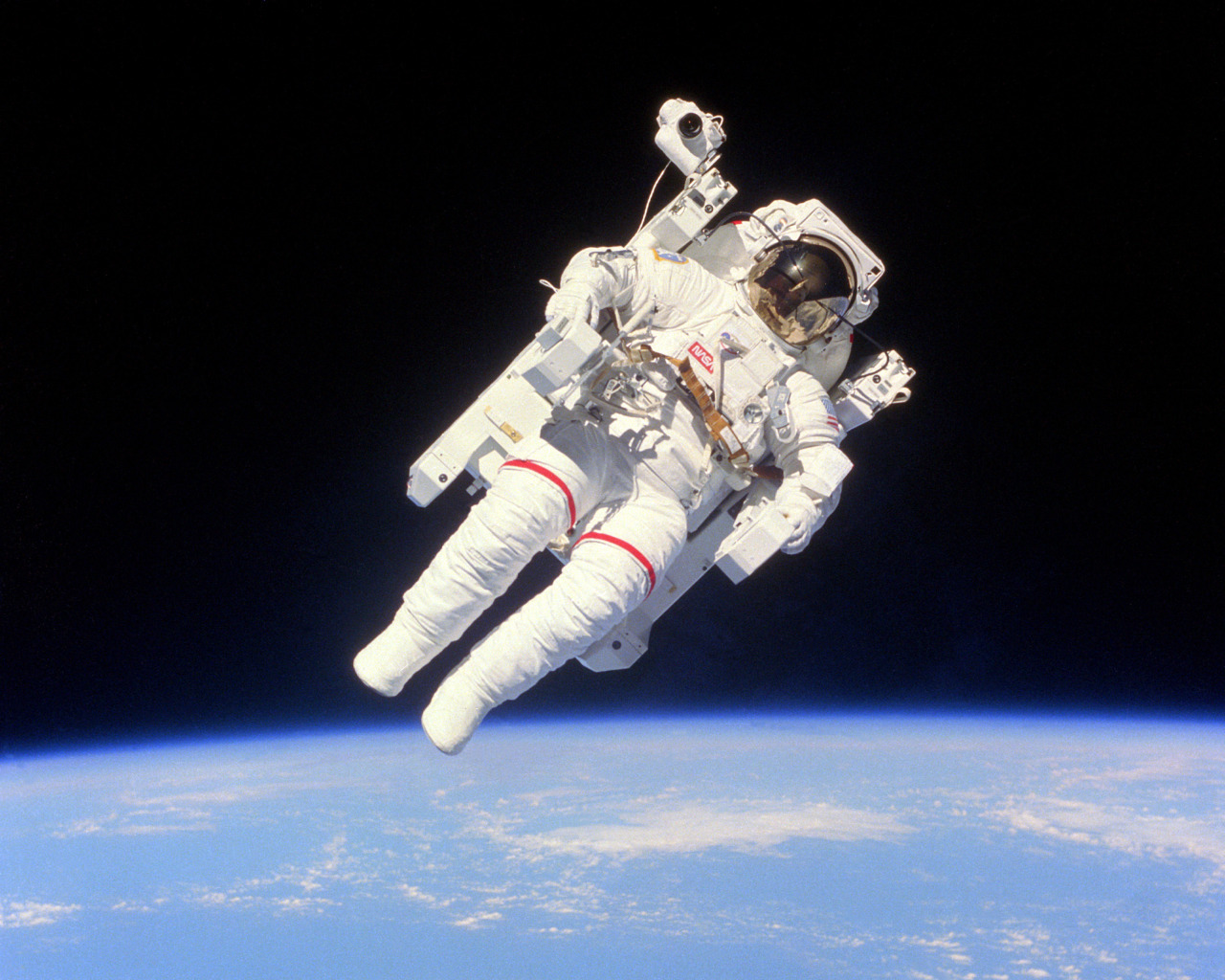 Astronaut Bruce McCandless II floats a few meters away from the cabin of the earth-orbiting Space Shuttle Challenger as part of an historic Extravehicular Activity (EVA) during Flight 41-B. This is the first use of the nitrogen-propelled, hand-controlled device called the Manned Maneuvering Unit (MMU), which allows astronauts to move freely in space without a tether, 02/07/1984