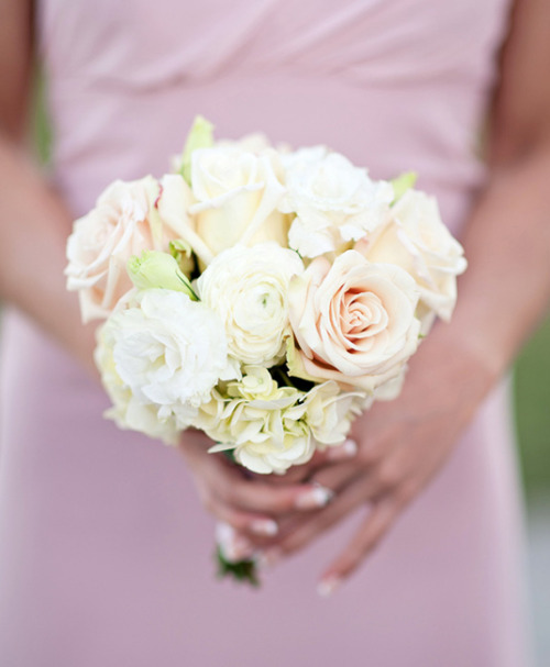 An assortment of delicately beautiful blossoms - lisianthus, ranunculus, roses, hydrangea - accents blush pink bridesmaid dresses. Image by KWP Weaver