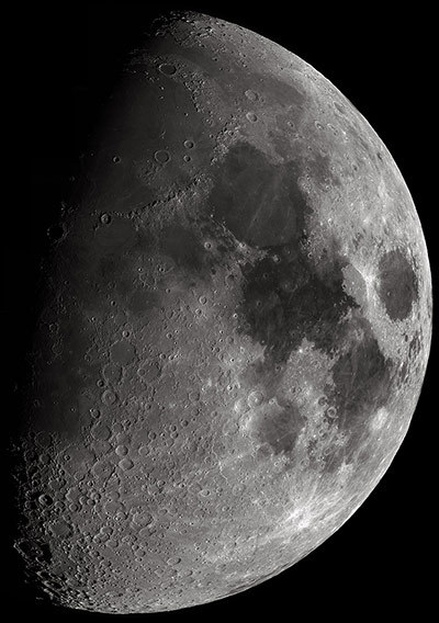 A multi-image mosaic of the moon. Even a telescope with low magnification will only show a small part of the moon's surface at a time, so composite images such as this are needed to show large areas of its surface