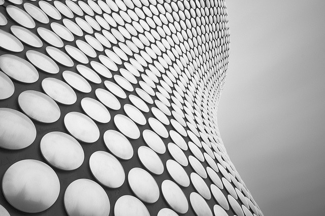 Selfridges on Flickr.Its a very long time since I've visited the bullring - 1992 was the last time I was there, I'd been to a James concert in Manchester and we were travelling back on a National Express coach back home to Greenwich. It was around this time of year and the weather turned - in fact turned so much that the police shut the M6 - all the coaches got diverted to Birmingham bus station where we spent much of the day - actually we found a pub just round the corner from the bullring. The roads didn't open and we spent the night sleeping under a table in city hall with red cross food parcels and fine bone china !!! It was an experience for sure. Its difficult to remember what the bullring was like then - it was cold, the big round building was there - but the rest of it shabby to say the least. Today's a different story though - Birmingham's gone up market. I've been wanting to visit birmingham for ages - of course Selfridges was a big draw - but surely there must be something else there too - so I decided to take a trip up and have an explore. I'm afraid there's potentially a few of this facade - I know its been taken a million times - but it really is rather striking. The day was cold and seriously overcast - by 9am (having arrived at 7am) I could have called it a day - seriously chilled to the bone, but I grabbed a coffee warmed up and went exploring a bit more. In the end I quite enjoyed my day there - there's a couple of shots I wasn't able to get so I'll be back at some point. For now a mini series follows. Oh - and I've been playing at the higher end of the histogram. I see lots of dark black architecture images - I'm guilty of that too - and some of them do look stunning but I'm keen to explore the other end - the end that we usually get in the UK and taking shots with completely overcast skies. Quick question - is the reflection of the cathedral distracting? I quite liked it I thought it added a sense of reality perhaps - but I have one where this is not there - would be interested in your views.