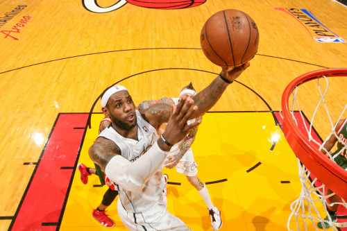 nba:  LeBron James of the Miami Heat drives to the basket against the Milwaukee Bucks in Game Two of the Eastern Conference Quarterfinals during the 2013 NBA Playoffs on April 23, 2013 at American Airlines Arena in Miami, Florida. (Photo by Issac Baldizon/NBAE via Getty Images)