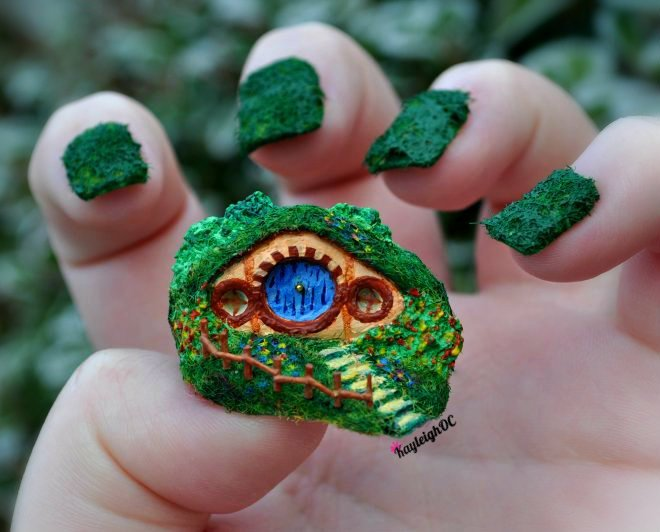 A little Hobbit-hole!:DHere is the second set of my Hobbit-y themed nails (the first being my Gandalf set which is here). I did warn you! I said it would be crazy and you can't say I was lying ;) Although, weirdly, this set is slightly more practical than most of my others, haha.I've never tried anything on this scale before. It's a solid, 3D nail which is supposed to resemble a little Hobbit-hole :) It's about an inch long and an inch high, made using clay, fake grass stuff and acrylic paints/nail varnishes.It's not based on any one particular Hobbit-hole, but it might be how I'd want mine to look if I had a real one :) Once I've worn them, I might keep it as a little ornament, or make it into a ring… ;DI won't be making anything as ridiculous as this for a while, haha. But it is so fun, so I'm sure it won't be my only nail 'ornament' ever ;)