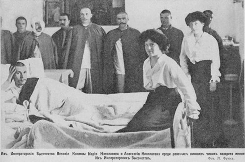 Grand Duchesses Maria and Anastasia visiting some wounded soldiers: 1915. (this one was new to me)