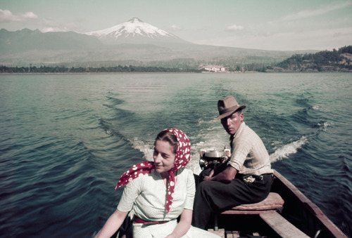 natgeofound:  A couple rides in a motorboat on Lake Villarrica in Chile, July 1941.Photograph by W. Robert Moore, National Geographic  Oh yeah, would rather be doing this today.