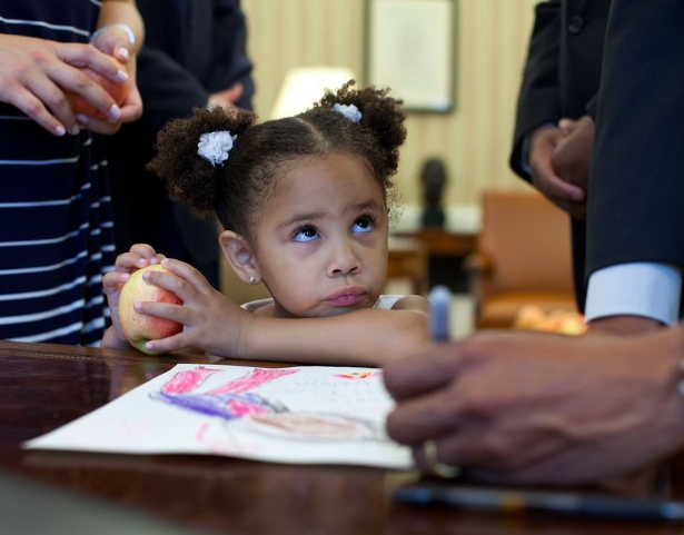Luz Graham-Urquilla, 4, watches President Obama as he signs her drawing at the Resolute Desk in the Oval Office, May 25, 2012  Look how bossy this little girl looks.