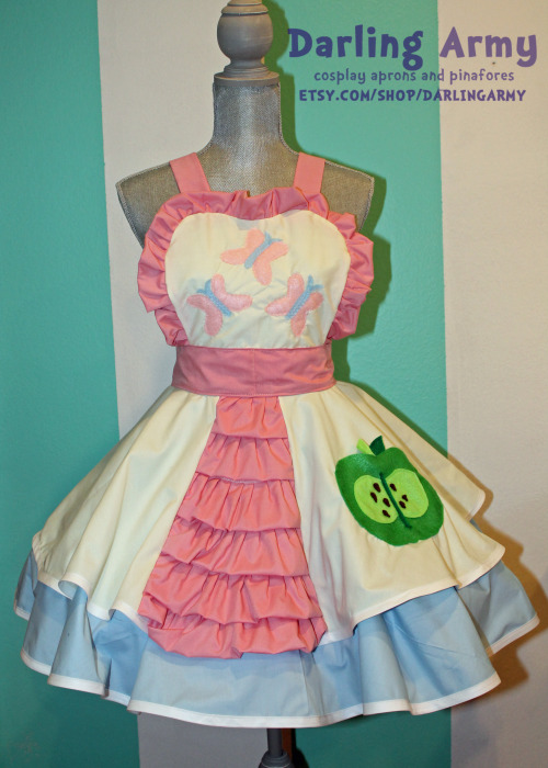 Custom Fluttershy/Big Mac Cosplay Pinafore Commission Custom Cosplay Pinafore Commissions are Open - Darling Army Yay! Another commission done! This is a super-customized pinafore based off of my original pony pinafore sketches I posted on my tumblr way back when. The commissioner requested a double skirt with the ruffle panel, a blue underskirt, and a Big Mac cutie mark pocket. I love that she wanted to incorporate her favorite pairing into one outfit (Fluttershy and Big Mac). Also, hurray for pastel colors!