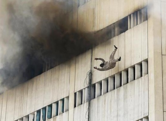 losed:  A man falls from a high floor of a burning building in central Lahore May 9, 2013. Fire erupted on the seventh floor of the LDA plaza in Lahore and quickly spread to higher floors leaving many people trapped inside the building.