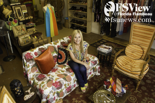 Owner Kristy Davis sits in her beautiful clothing store, Wonsaponatime Vintage located in Railroad Square.