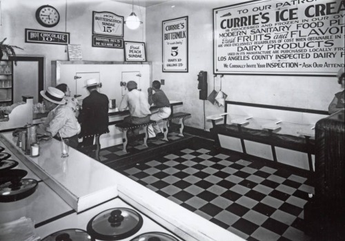 Patrons enjoying sundaes and buttermilk at Currie's Ice Cream Store, 3701 Beverly Blvd. in Los Angeles, 1937.